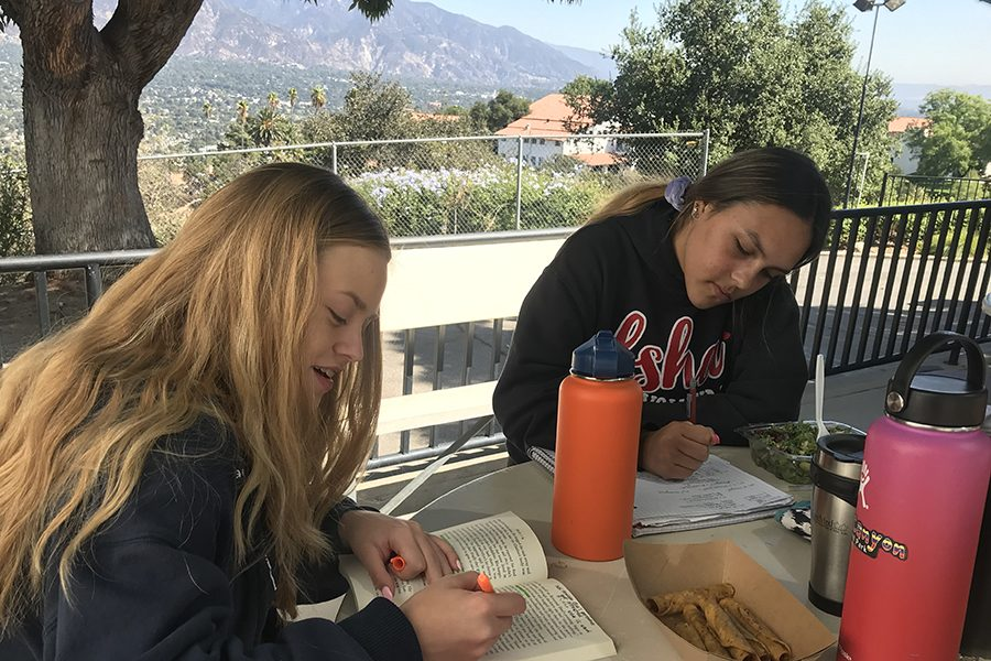 Gabi+Miller+%2721+and+Makena+Wilson+%2721+race+to+finish+assignments+before+the+bell+rings%3B+the+pressure+of+school+work+is+a+common+source+of+teen+anxiety.+%0A