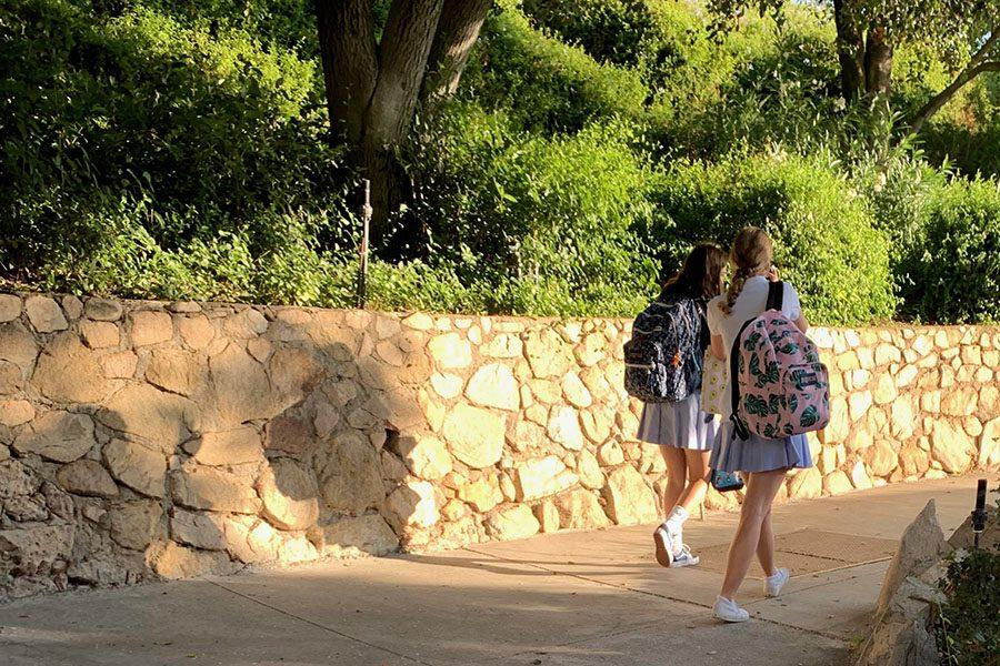 Claire McDonald '21 and AC Bailey '21 make their way to class in time for the new 8 a.m. start.