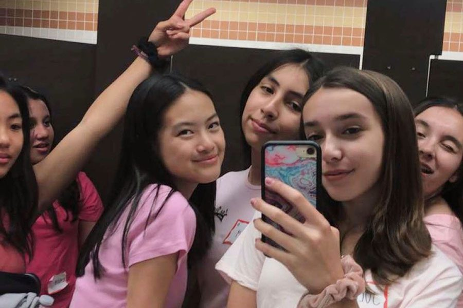 This group of freshmen had the best time of the mixer taking group mirror selfies.