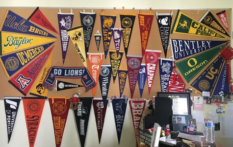 College flags fly high in the college counseling cottage.