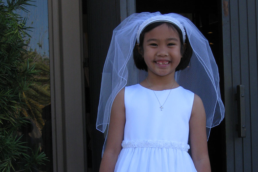 The author on the day of her first Holy Communion.