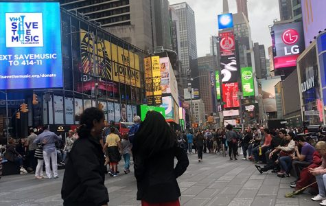The author and Nikki Ariki '20 bask in the energy of Times Square on the East Coast College Tour 2019.