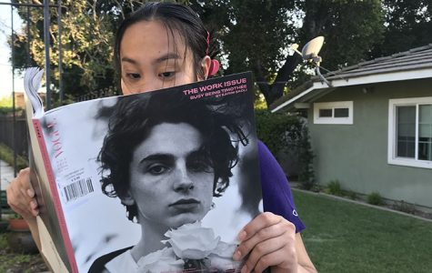 Not even this oversized, international edition of Vogue can contain the beauty of Timothée Chalamet.