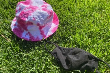 The author refers to the hue of the pink on this tie-dyed bucket hat as