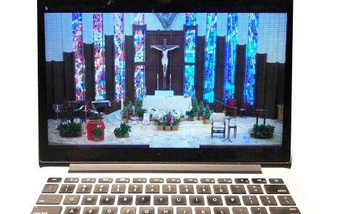 From her couch instead of from the pews, the author attends Sunday mass at St. Bede's via livestream.