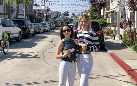 Looking like locals! Seniors Beatriz Giménez Cerezo and Emmie Barnard soak up the Newport sun, eat chocolate-covered bananas and match in white jeans.