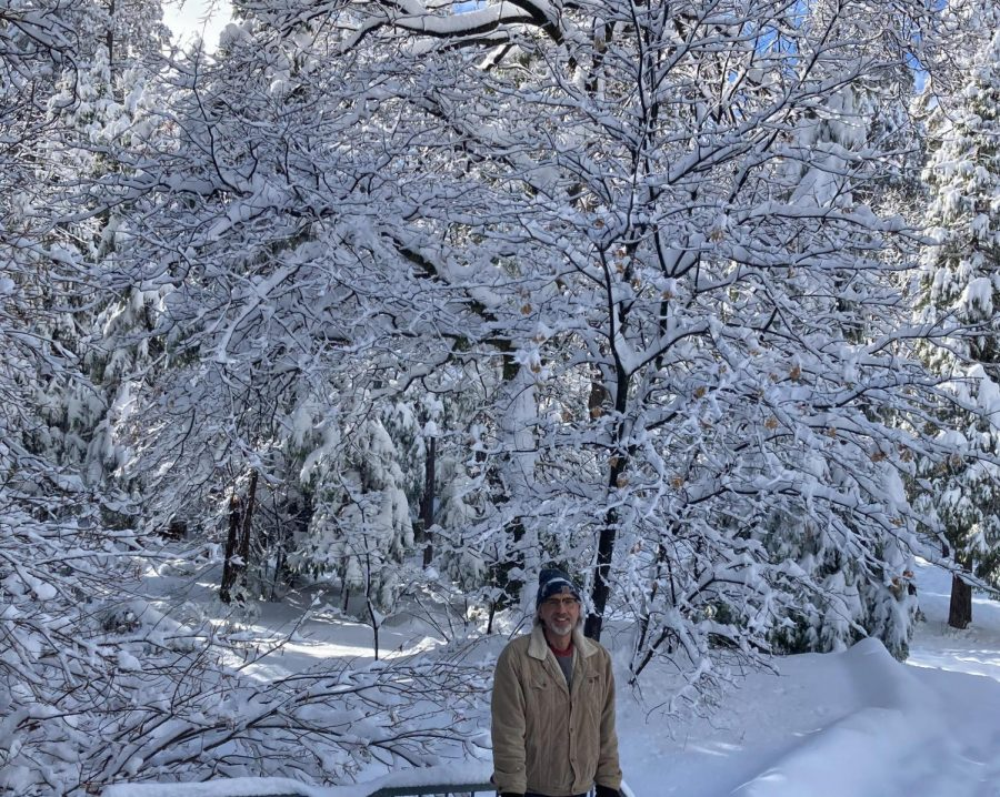 Byrne's dad stops for a photo during a walk through Lake Arrowhead's snow-capped trees.