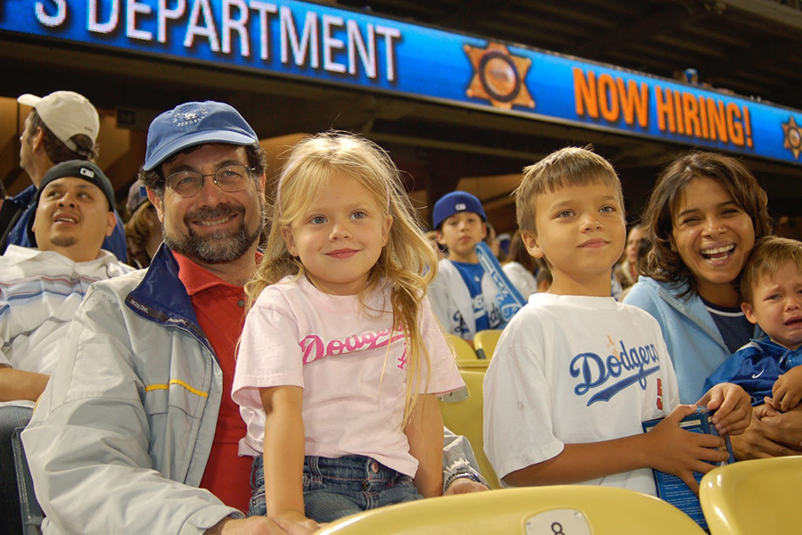 A much younger Gabi Miller '21 watches a Dodger game from her father's lap, the rest her family to her right. Clearly, Miller's much happier to be there than her younger brother.