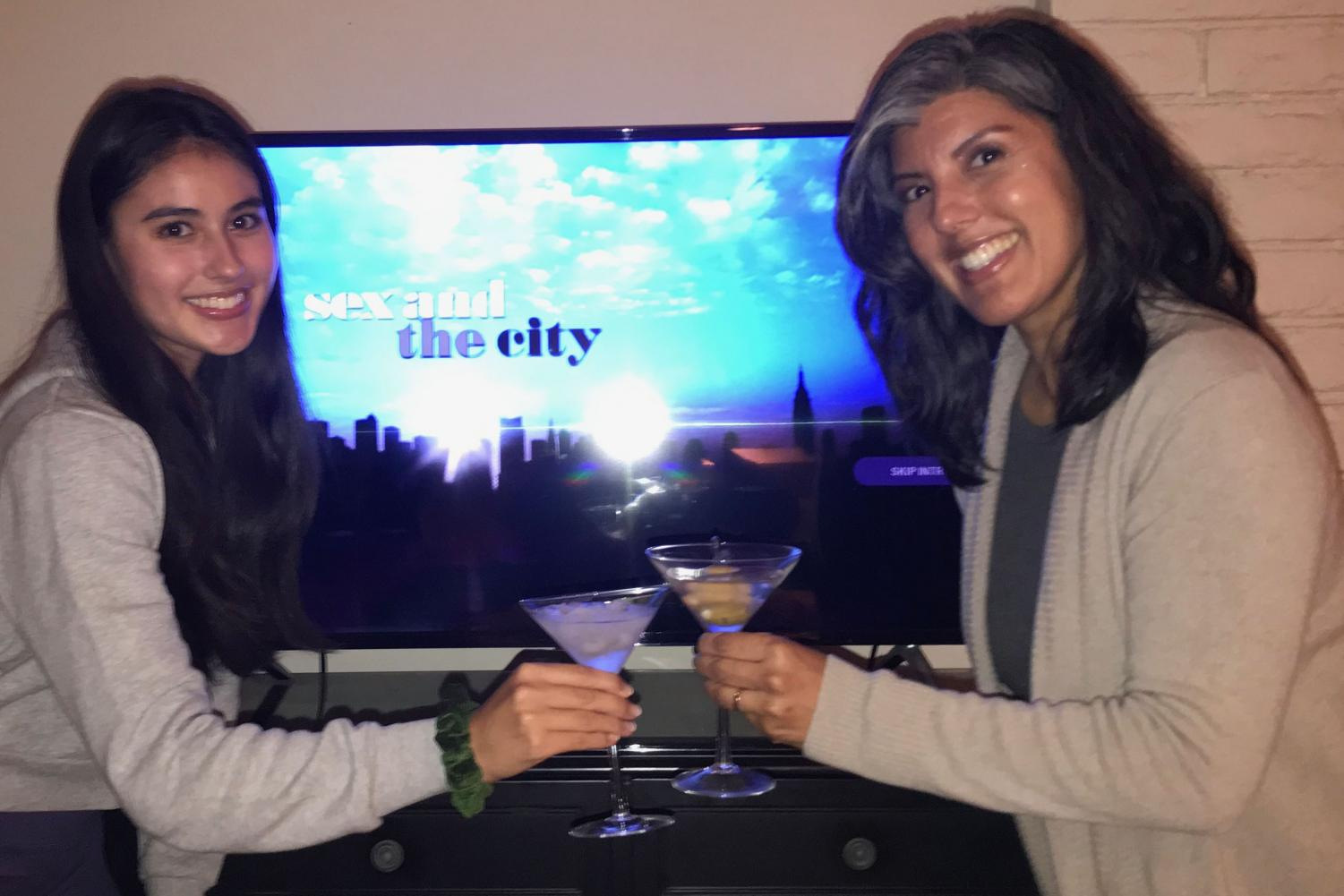 """Carisa Joyner '21 and her mother, Liana Yamasaki, enjoy a casual drink while bingeing """"Sex and the City."""" But don't worry! Joyner's martini glass is filled with ice and water."""