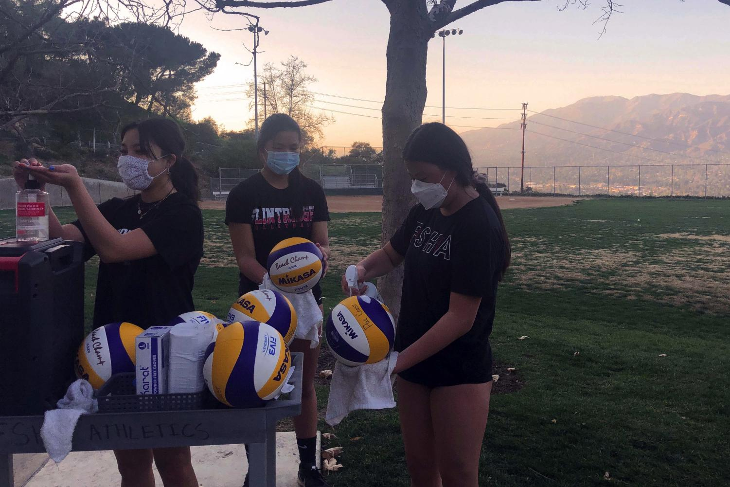 Volleyball players (from left to right, Angelina Cao