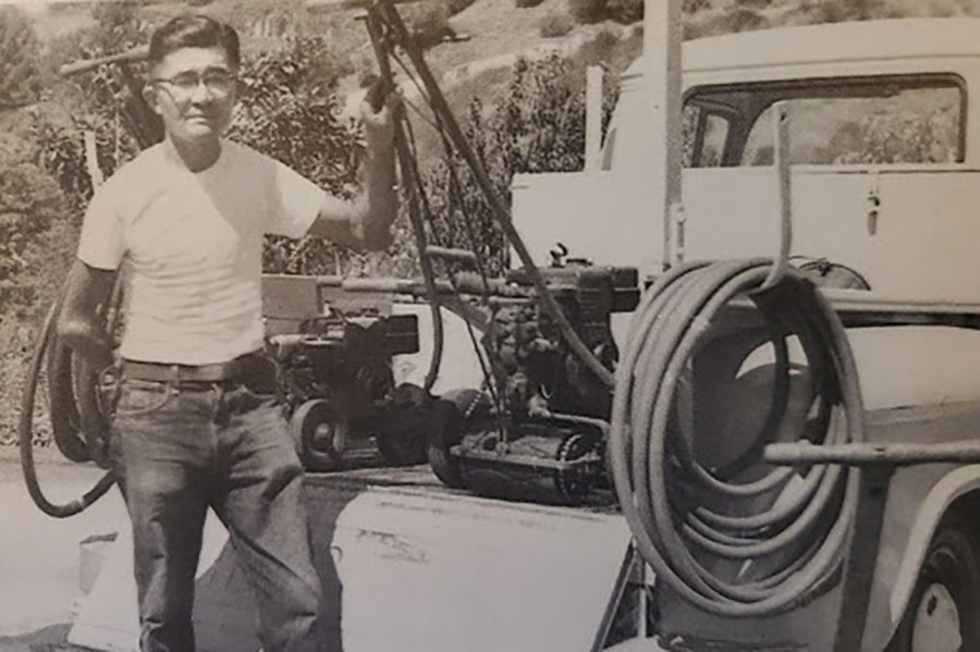Dr. Robert Sanderson's grandfather, Toshio Yamagata, stands beside his gardening truck in Los Angeles, CA.