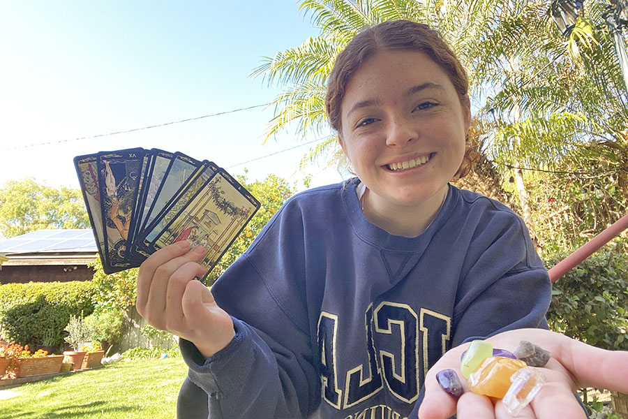 Jordyn Hart '21 shows off some of the features of her New Age spirituality: crystals and tarot cards.