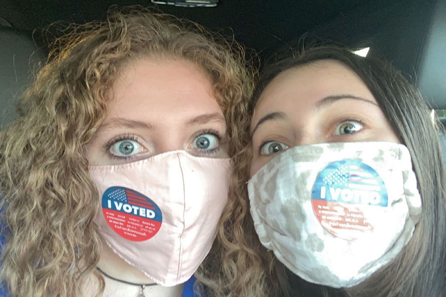 Mask up! Isabella Durand '21 (left) and Joelle Souma '21 (right) headed to the polls in Souma's car back in November. While it was fun to exercise their rights, they had even more fun driving there.