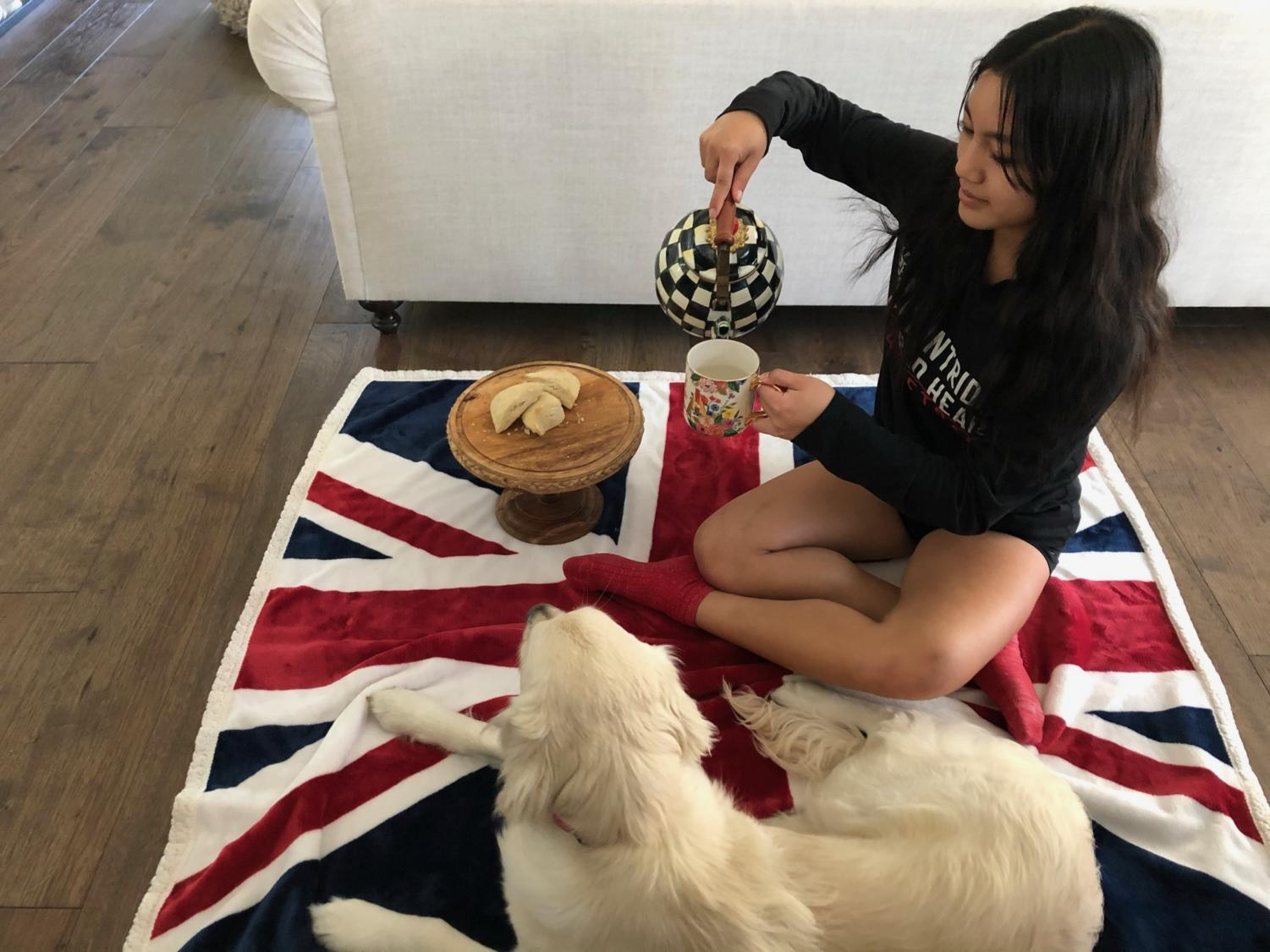 Fancy teapot? Check. Scones? Check. Union Jack blanket? Check. With the English essentials in place, Angelina Cao '22 settles down for a pretend tea at Buckingham Palace.