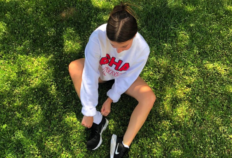 After a long day of online school, MJ Von der Ahe '22 gets ready to de-stress by putting on her shoes and going for a run.