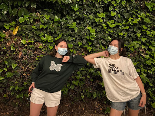 Joelle Souma '21 gives Christina Costanzo '21 a friendly elbow bump during their first get together after quarantine.