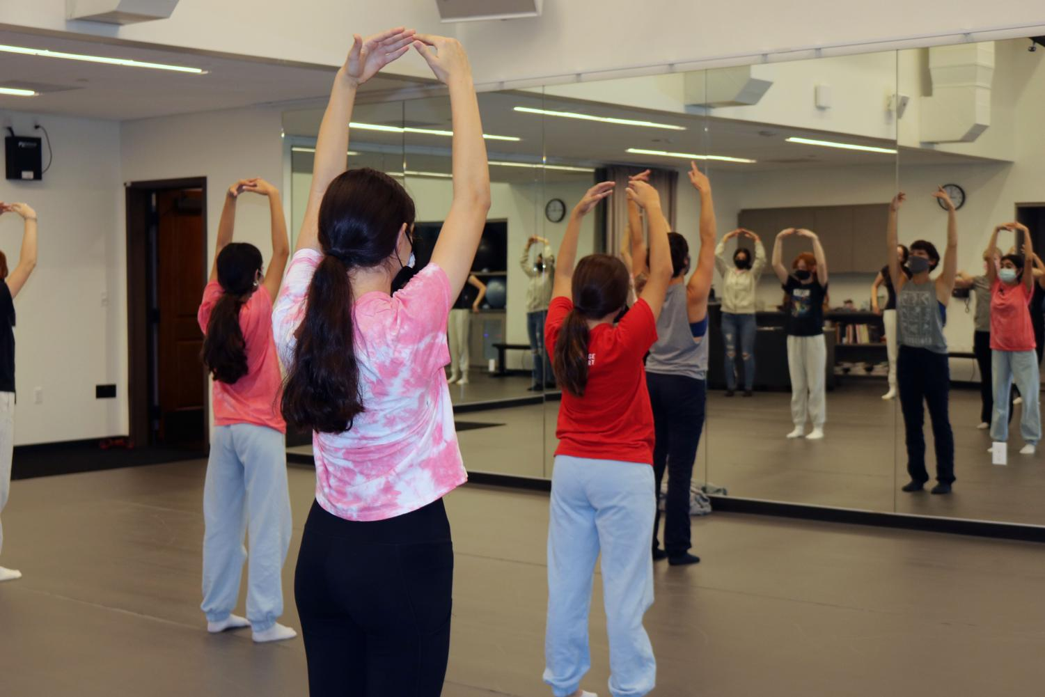 In the Hills new, state-of-the-art dance studio, teacher Jessie Ryan (in front wearing gray) teaches students new choreography.