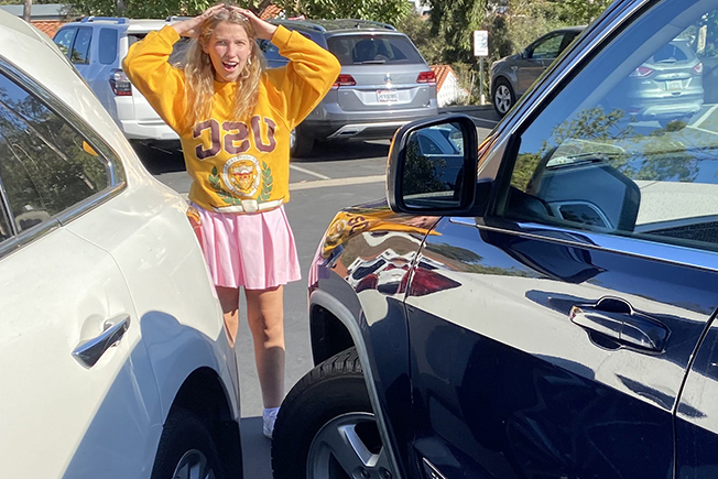 After one month with her driver's license, Michelle St. Denis' 22 still cannot park between the lines in the school parking lot.